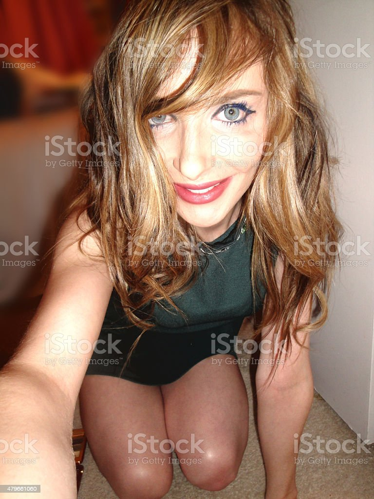 Blonde girl takes a playful selfie stock photo