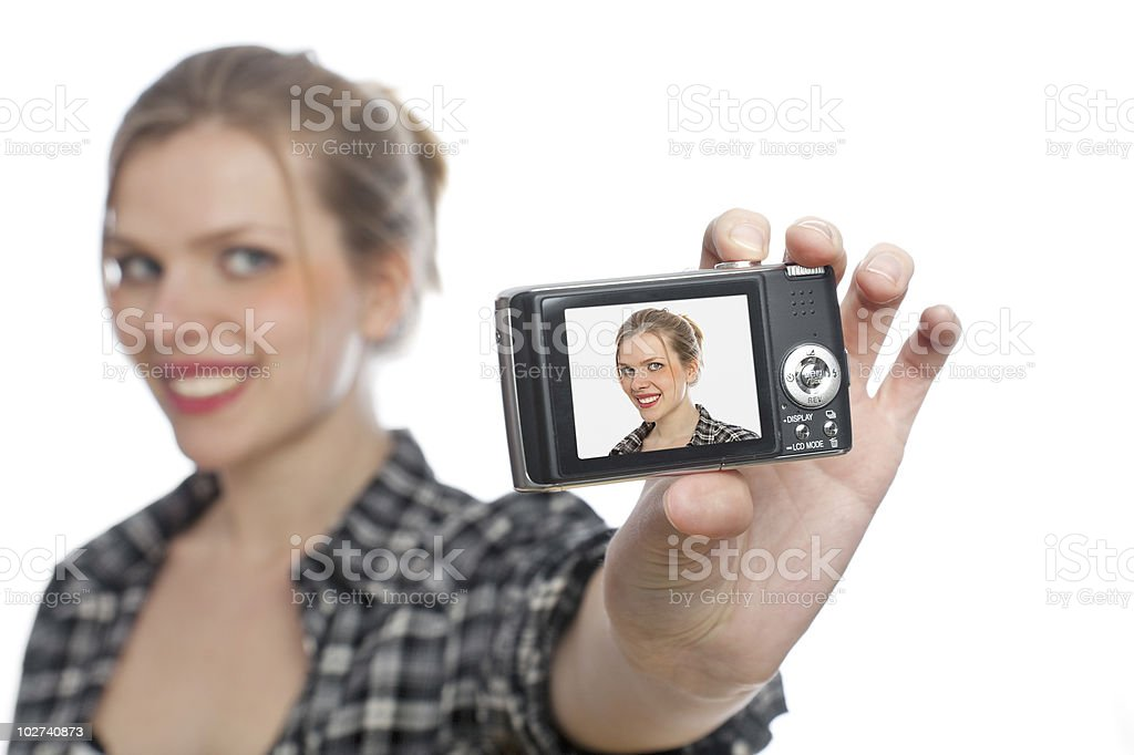 blonde girl taking picture of herself with a digital camera stock photo