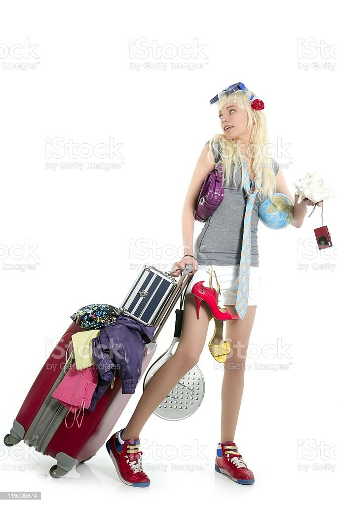 Blonde girl with a filled suitcase isolated on white royalty-free stock photo