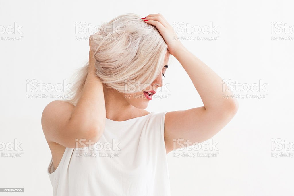 Blonde girl with bad hair stock photo