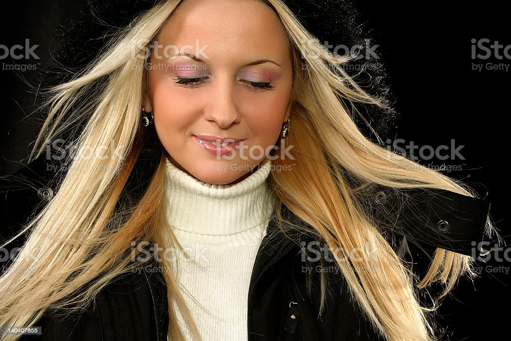 Blonde girl with black hood royalty-free stock photo
