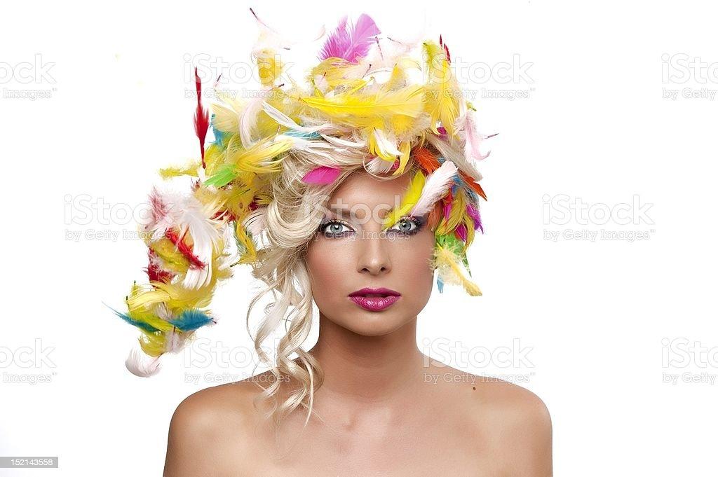 blonde fille avec des plumes photo libre de droits