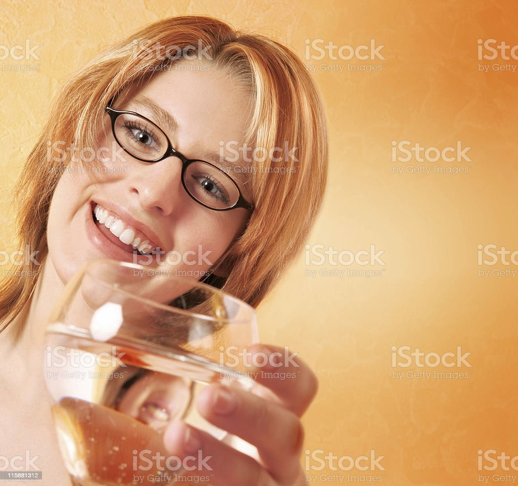 Blonde girl with glass royalty-free stock photo