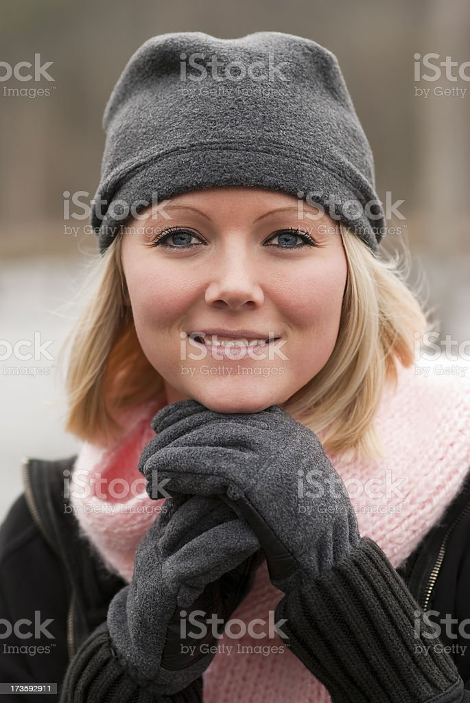 Blonde Girl with Gray Hat in Winter royalty-free stock photo