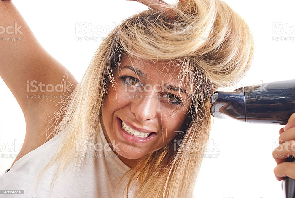 Blonde girl with hair dryer royalty-free stock photo