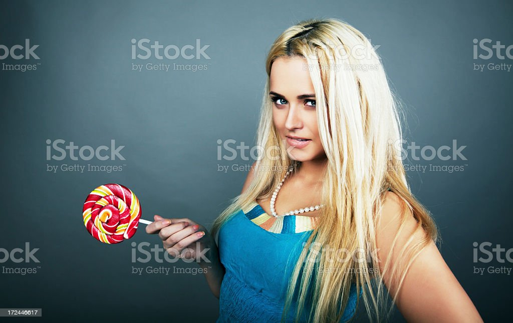 Blonde girl with lollipop royalty-free stock photo