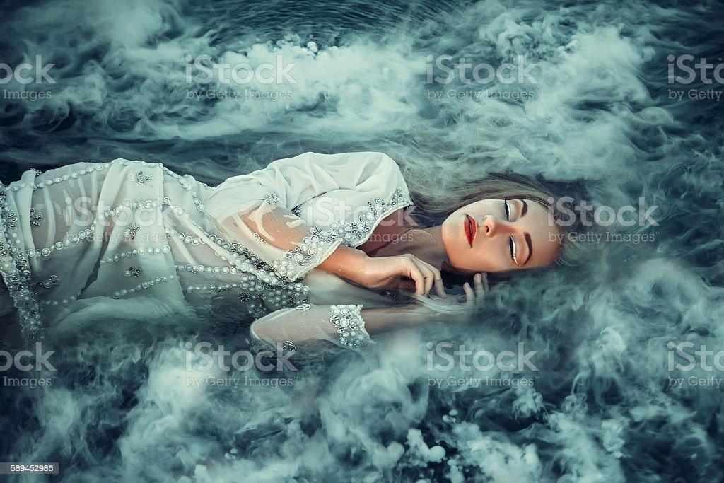 blonde girl with long hair in a vintage dress stock photo