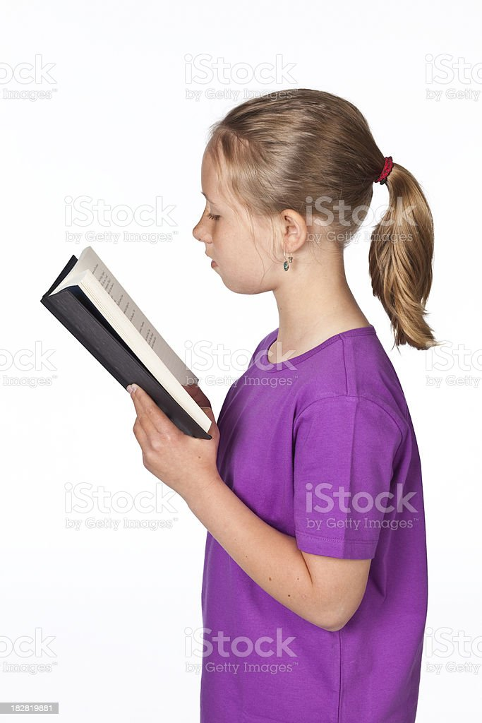 Blonde girl with pony tail reading isolated on white royalty-free stock photo