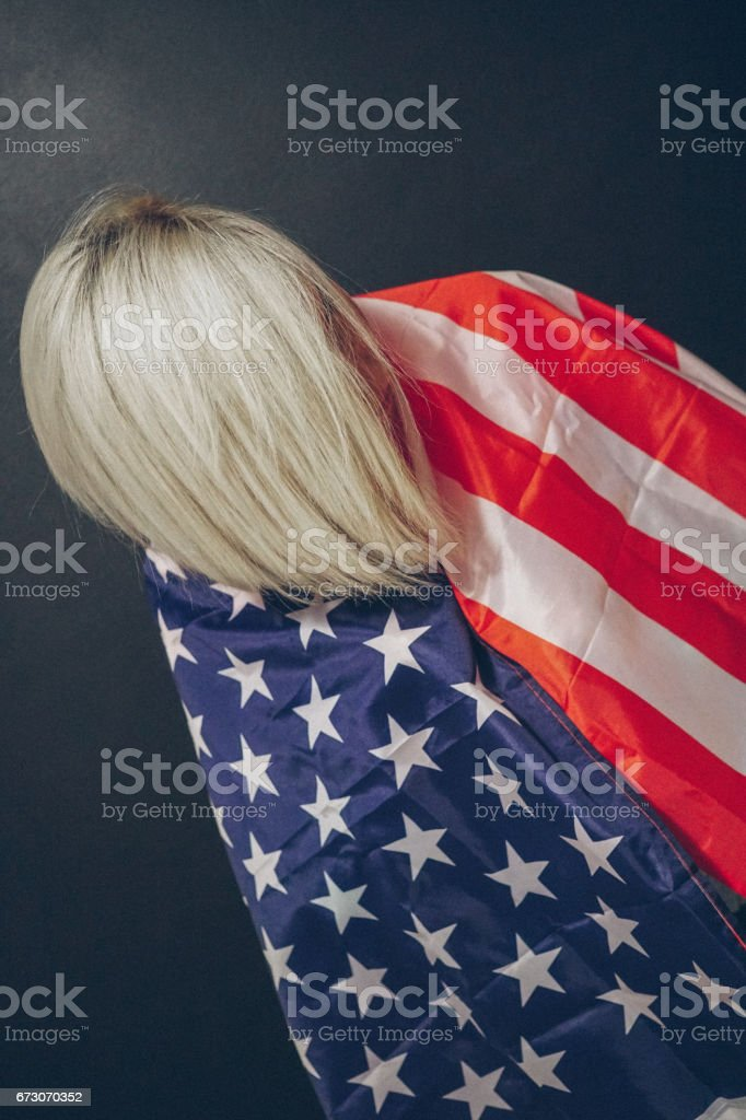 Blonde girl with USA flag stock photo