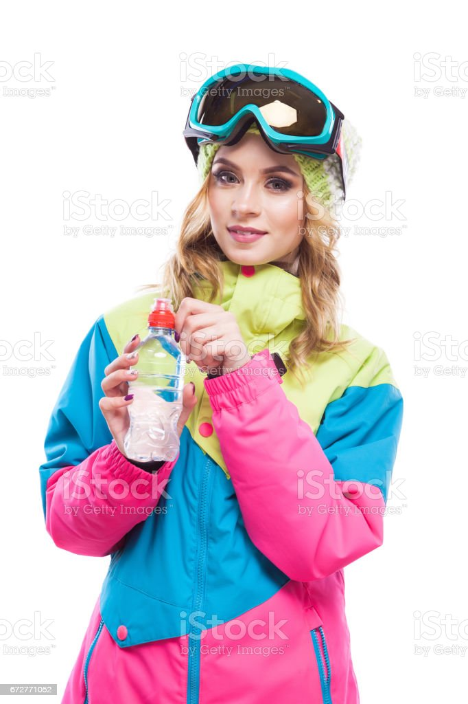 blonde girl with water bollte snowboard suit stock photo