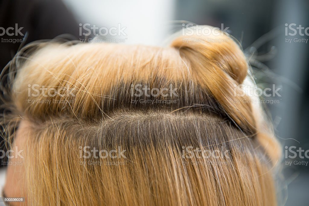 Blonde Hair Roots Showing, Close-up stock photo