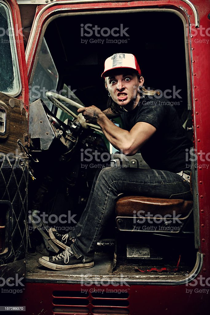 Blonde Haired Male Sitting in Old Truck stock photo