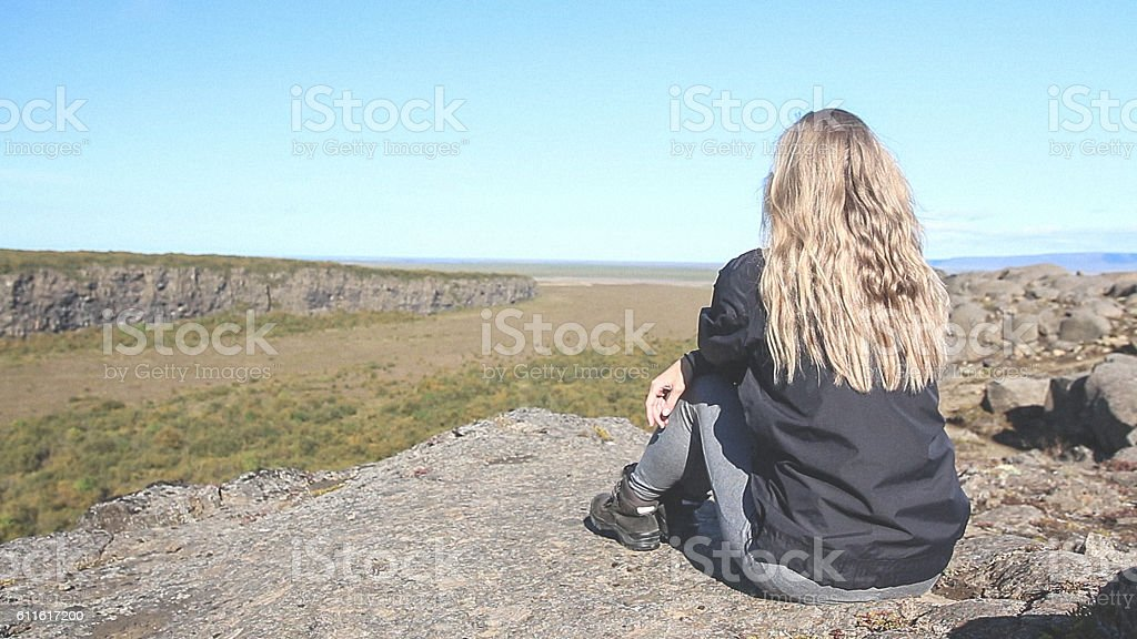 Blonde hiker looking at view stock photo