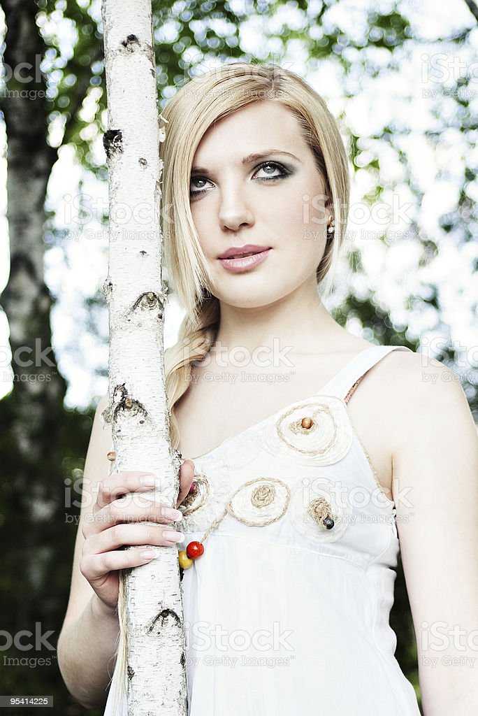 blonde holding young birch tree stem royalty-free stock photo