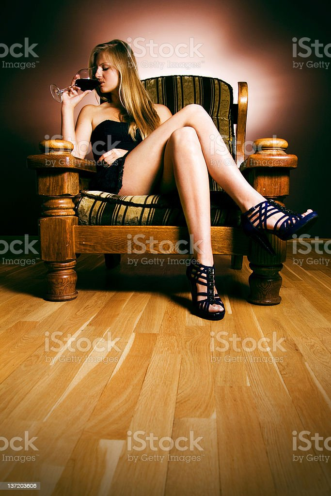 Blonde in an armchair royalty-free stock photo
