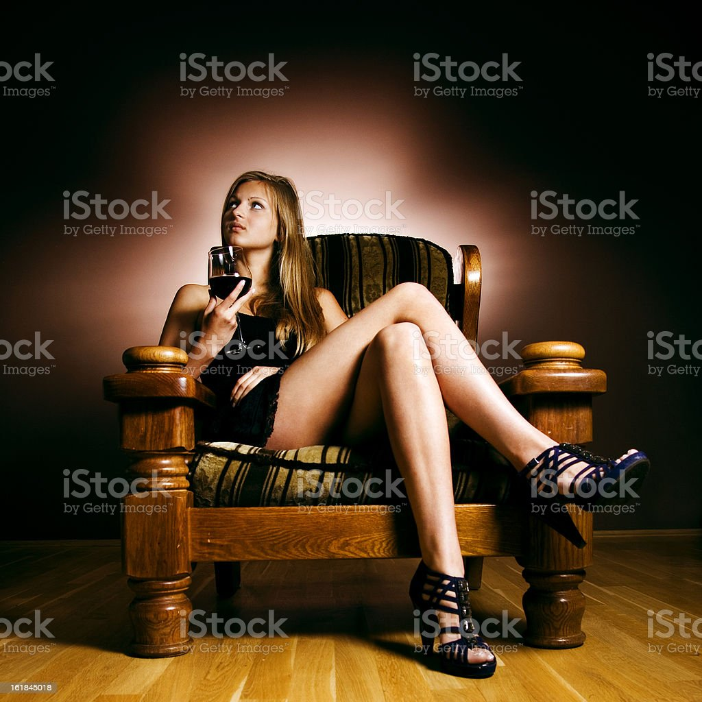 Blonde in an armchair stock photo