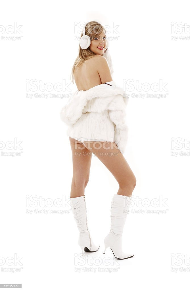 blonde in boots, fur and headphones royalty-free stock photo