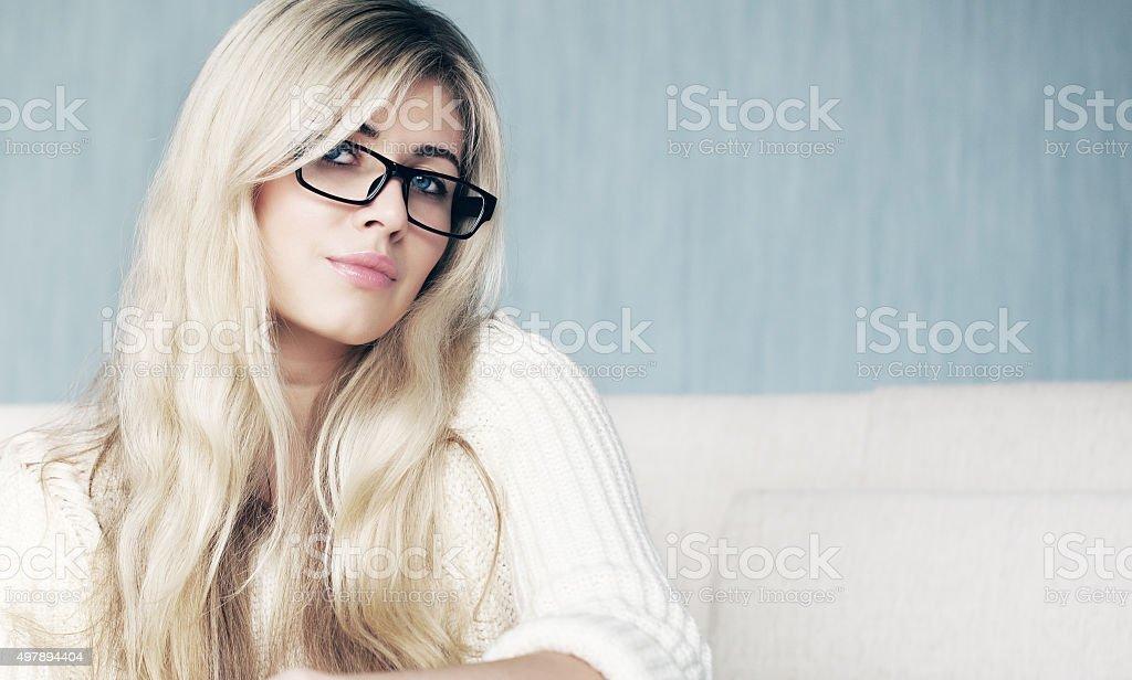 Blonde in classic glasses stock photo