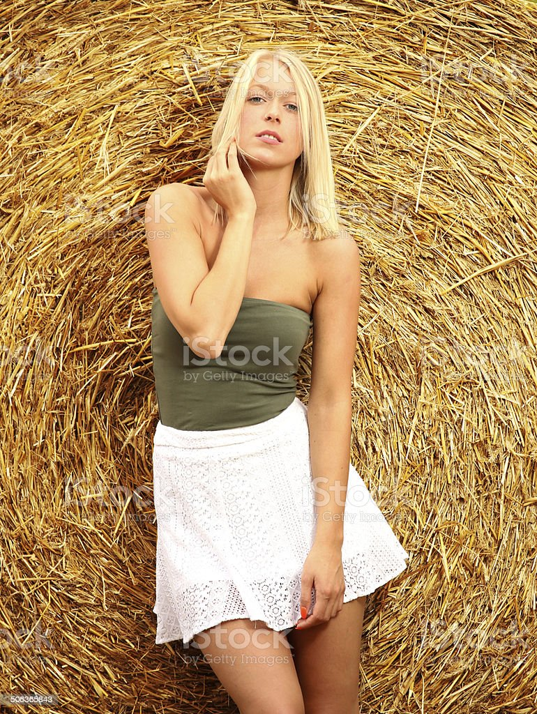 blonde in front of a strow ball wearing white rock royalty-free stock photo