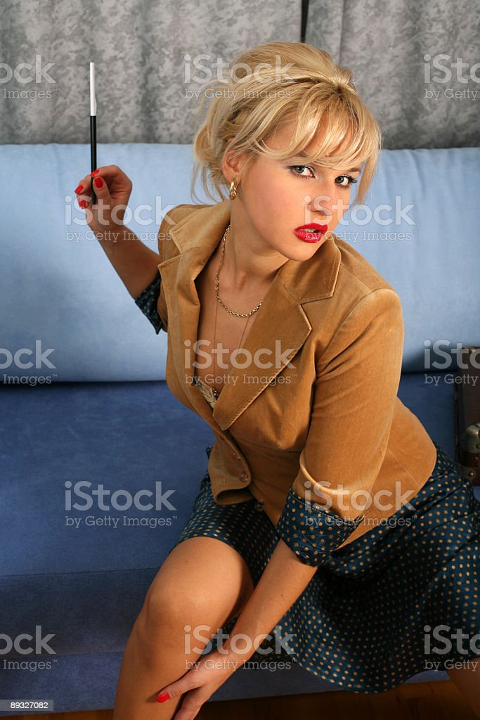 blonde in retro style posing with mouthpiece royalty-free stock photo
