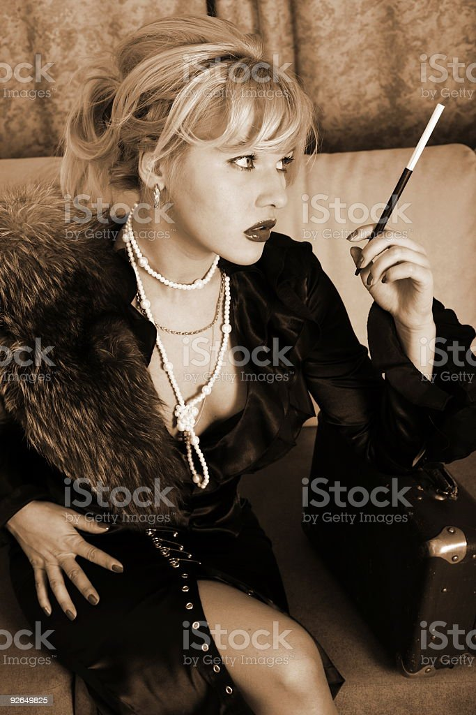 blonde in retro style posing with suitcase and mouthpiece royalty-free stock photo