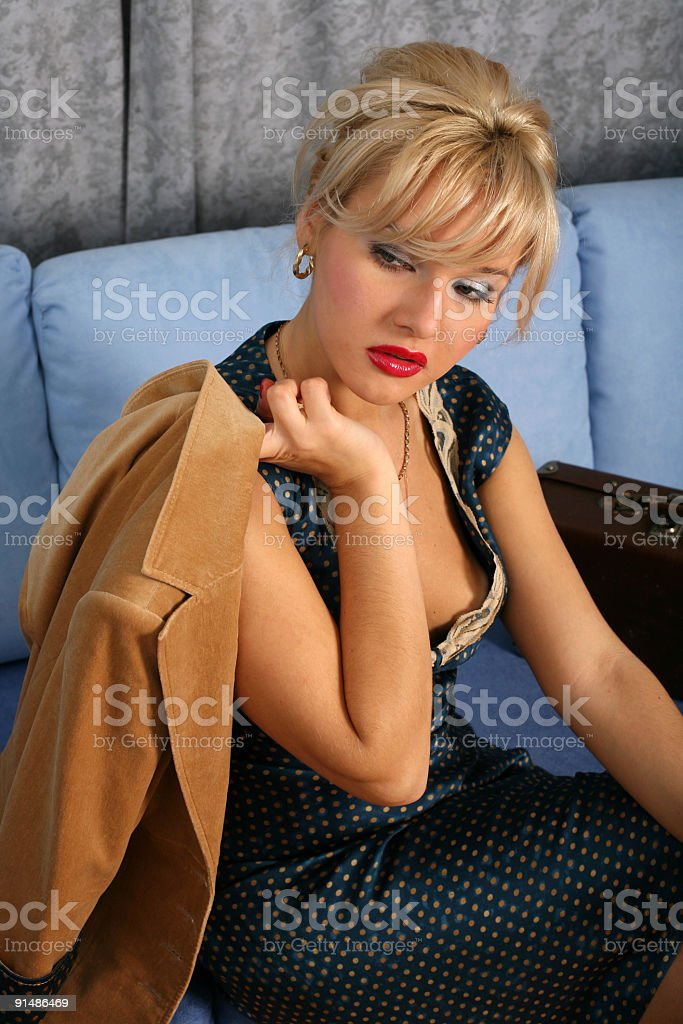 blonde in retro style posing with suitcase royalty-free stock photo