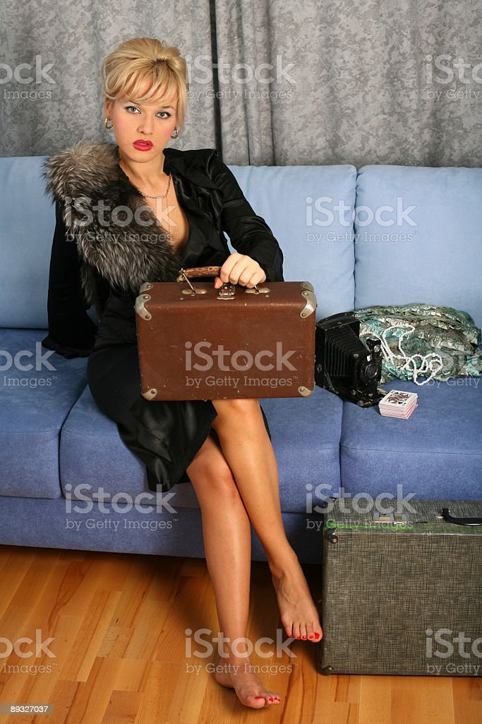 blonde in retro style posing with suitcases royalty-free stock photo