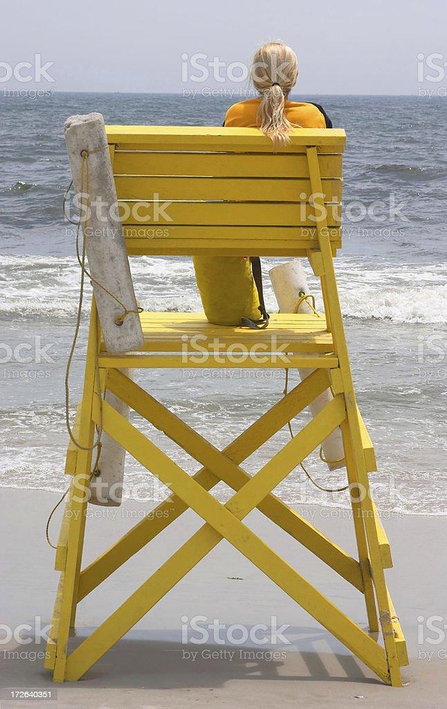 Blonde Lifeguard at the Beach stock photo