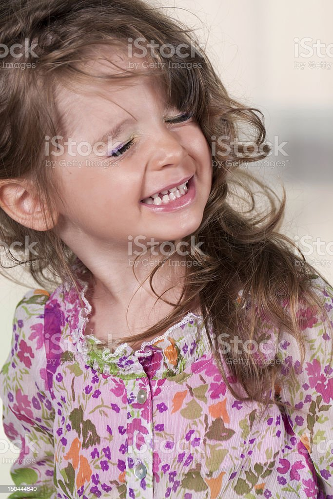 blonde little girl making a funny face stock photo