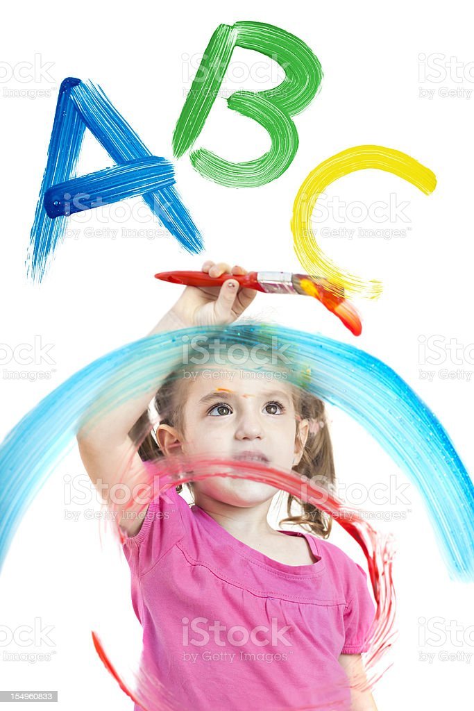 Blonde little girl painting ABC on different layers of windows royalty-free stock photo