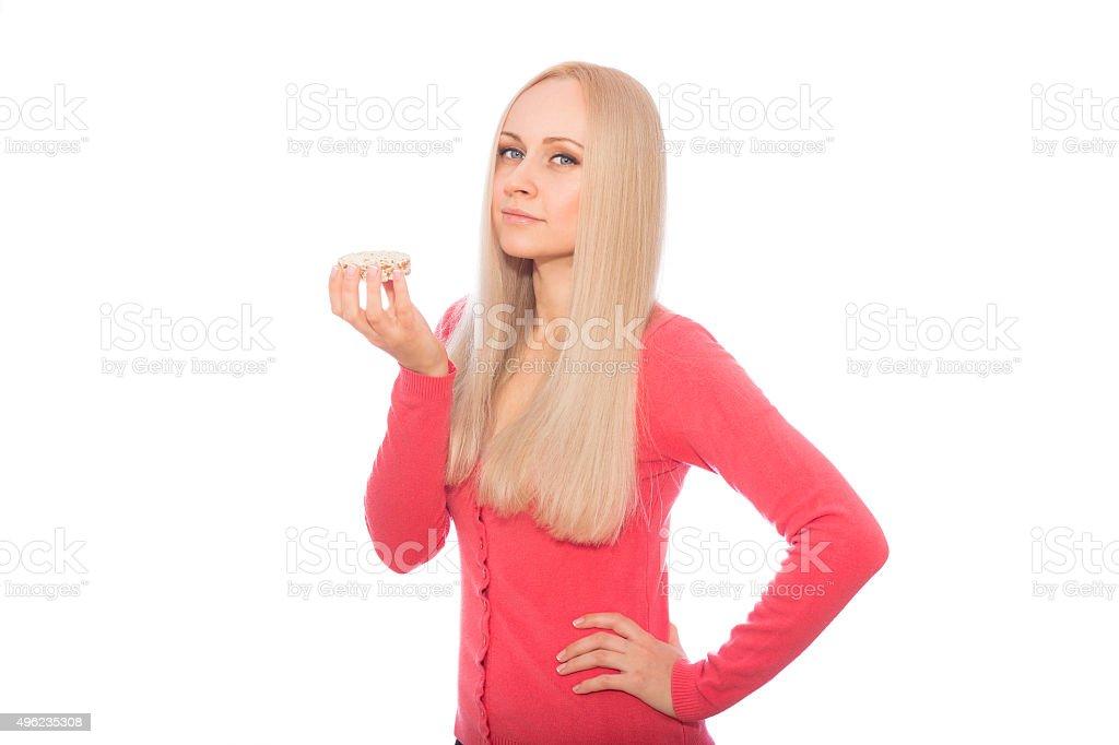 Blonde model are going to taste diet cracker stock photo