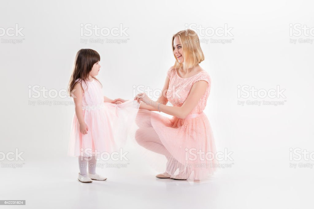 blonde mom and sweet little daughter in pink dresses princesses stock photo