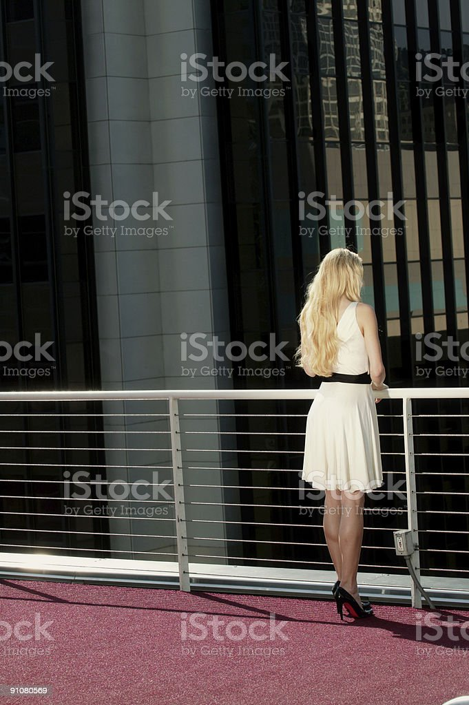Blonde on roof 8 stock photo