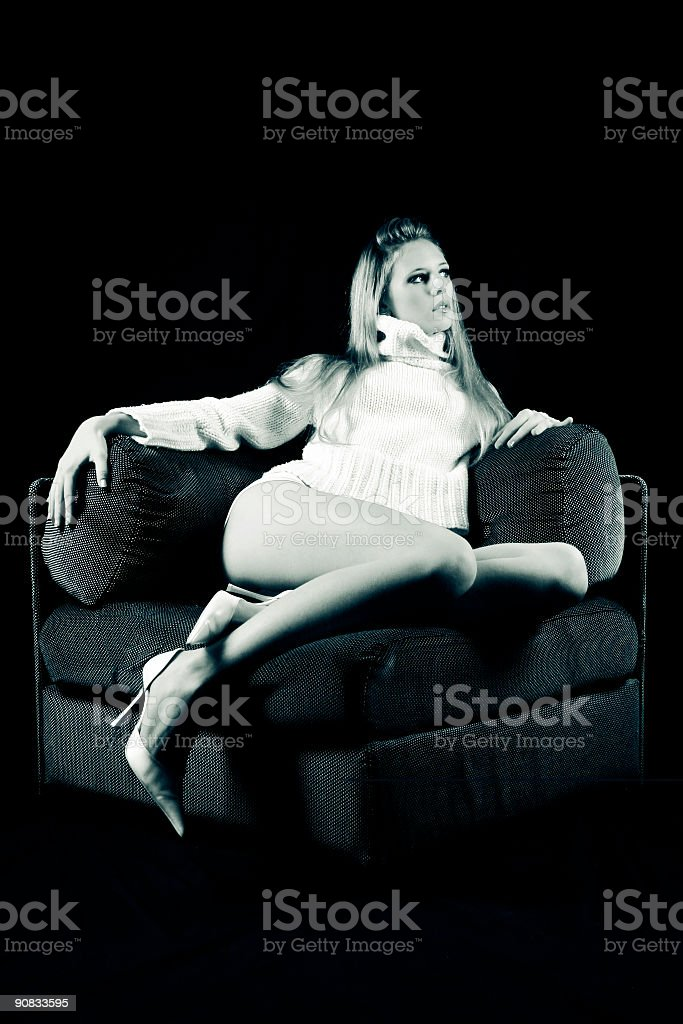Blonde on the couch 1 royalty-free stock photo