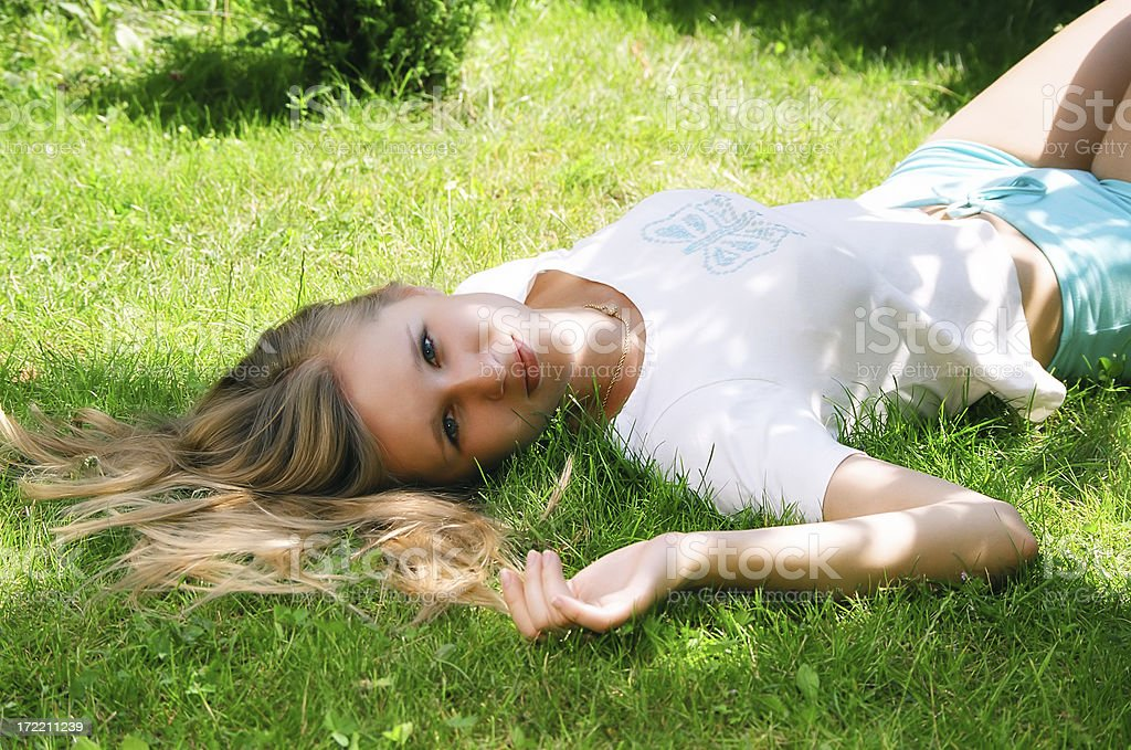 Blonde on the grass royalty-free stock photo