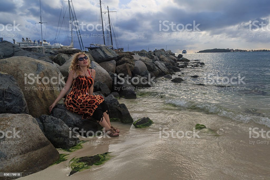 Blonde on the great bay of the St. Maarten. stock photo