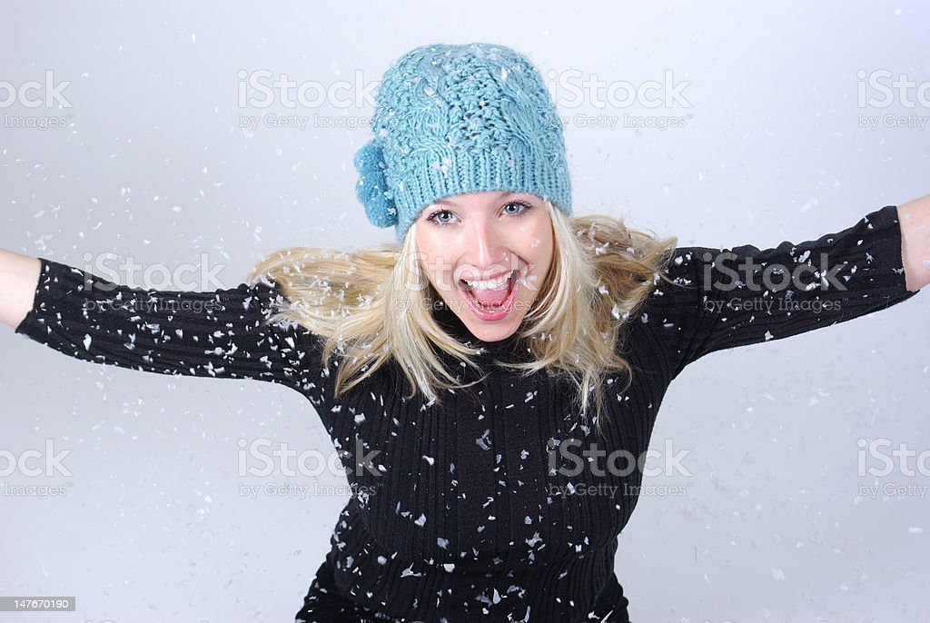 Blonde playing in snow royalty-free stock photo