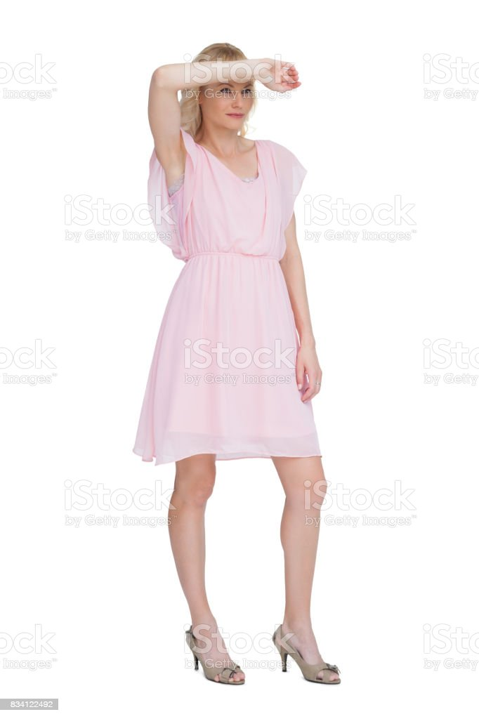 Blonde posing with hand on forehead stock photo