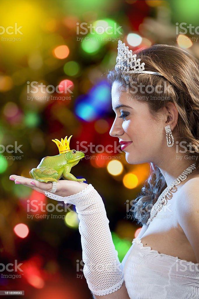 Blonde princess kissing a frog prince stock photo