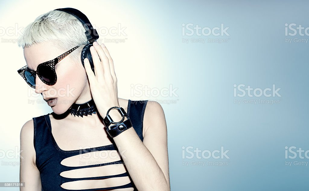 Blonde Sexy DJ. Black hardcore style. Crazy Party Time stock photo