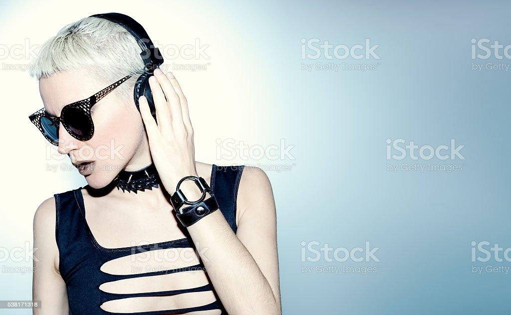 Blonde Sexy DJ. Black hardcore style. Crazy Party Time stock photo