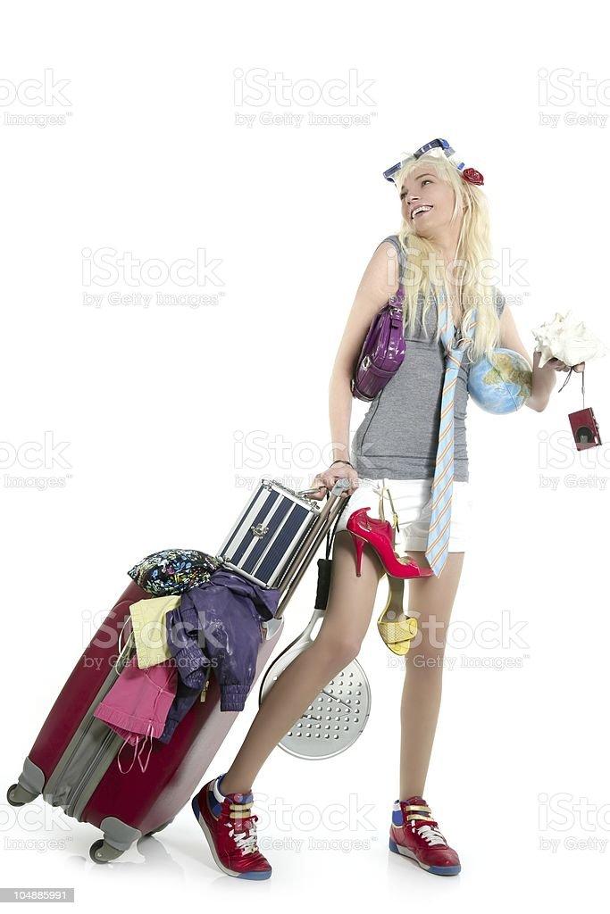 blonde shopping girl vacation metaphor suitcase full royalty-free stock photo