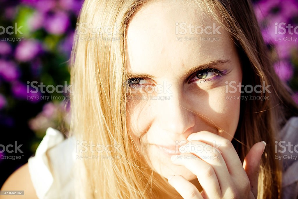 blonde smiling shy portrait stock photo