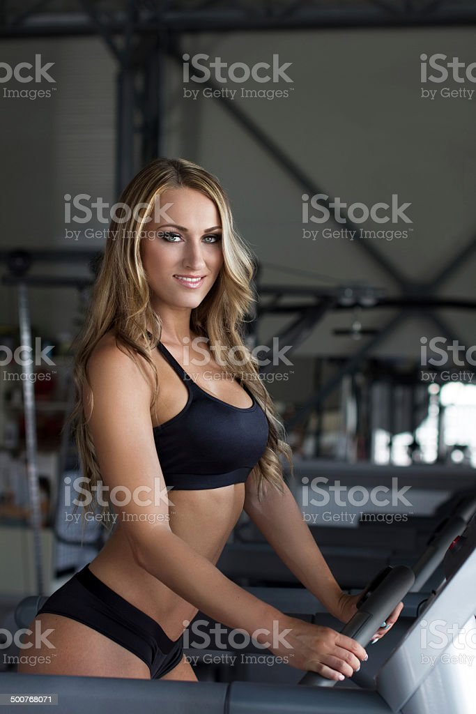 Blonde sporty woman on treadmill royalty-free stock photo