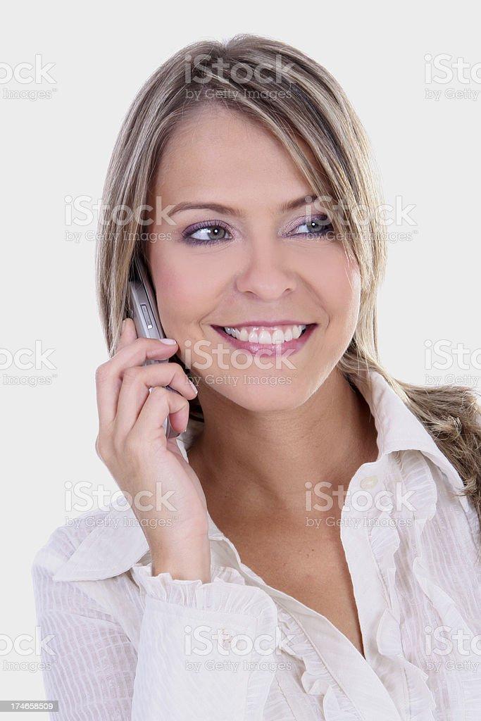 talking on cellphone la rubia - foto de stock