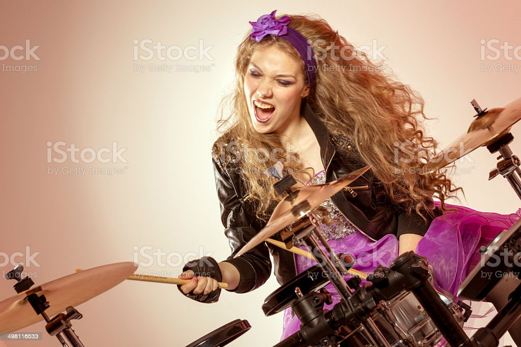 Blonde teen girl playing percussions royalty-free stock photo
