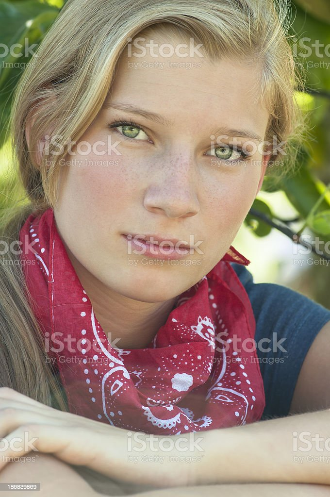Blonde teen girl with red bandana - I royalty-free stock photo