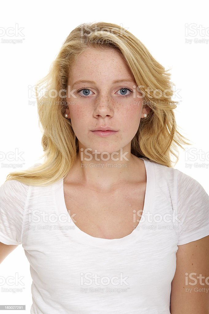 Blonde teenage girl with neutral expression royalty-free stock photo
