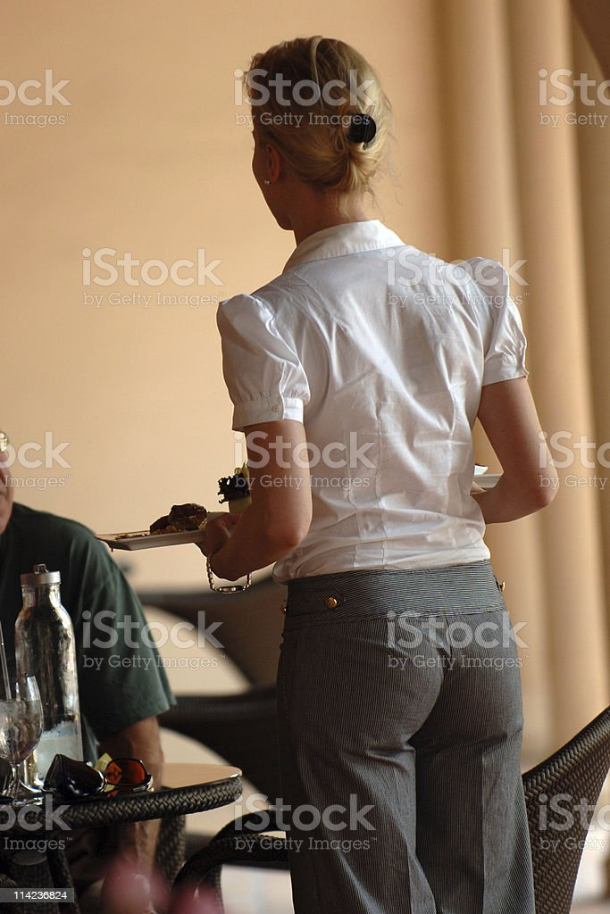 blonde waitress serving from behind royalty-free stock photo