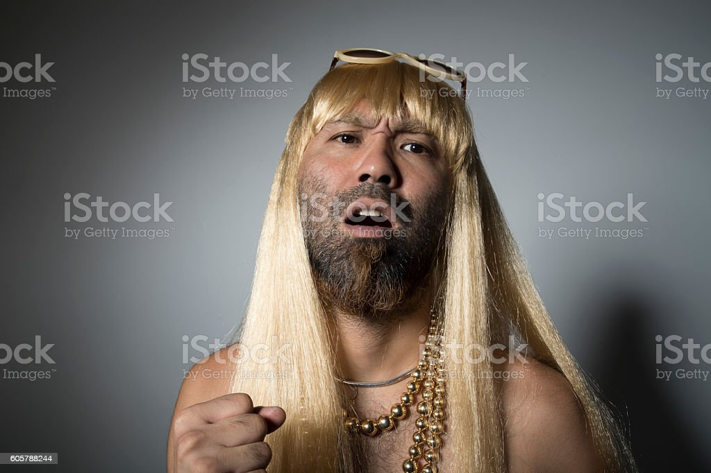 Blonde wig and yellow sunglasses. stock photo